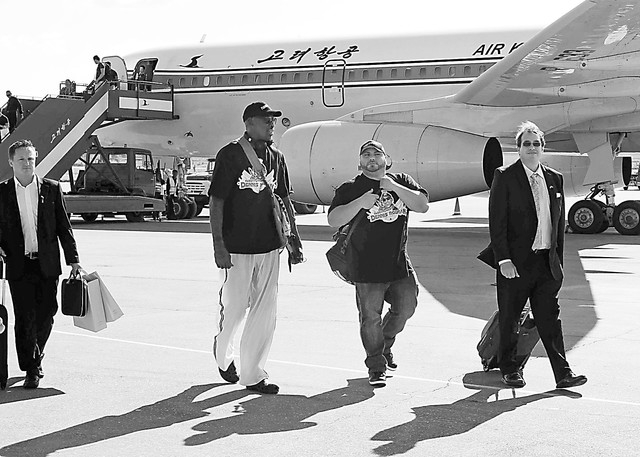 Former NBA star Dennis Rodman, third right,  arrives at Pyongyang airport, North Korea,  Tuesday, Sept. 3, 2013. Rodman landed Tuesday in North Korea and said he plans to hang out with authoritari ...