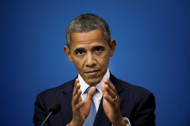 US President Barack Obama reacts during a press conference at Rosenbad, the seat of the Swedish government in Stockholm, Sweden, Wednesday, Sept. 4, 2013. US President Obama is on a visit to Swede ...