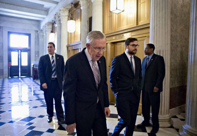 Senate Majority Leader Harry Reid of Nev. makes his way to the Senate floor on Capitol Hill in Washington, Friday, Sept. 6, 2013, to introduce a resolution to authorize military action to support  ...
