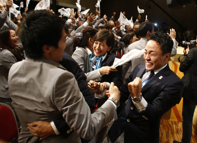 Members of the Tokyo 2020 delegation celebrate after Tokyo was awarded the 2020 Olympic Games during the 125th IOC session in Buenos Aires, Argentina. (AP Photo/Victor R. Caivano)