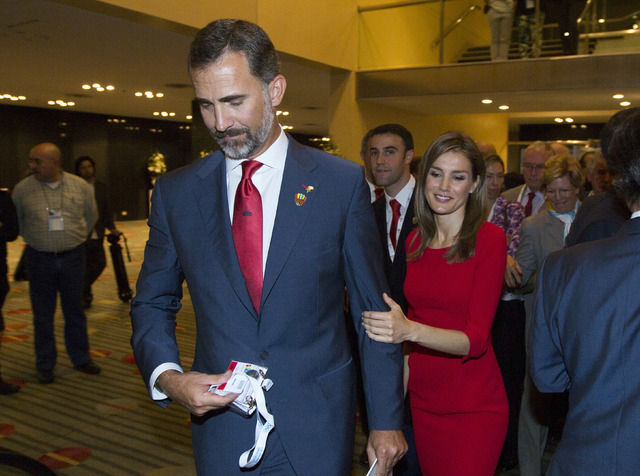 Spain's Crown Prince Felipe and and Princess Letizia leave after Madrid's 2020 final presentation in 125 IOC session in Buenos Aires, Argentina, Saturday. (AP Photo/Ivan Fernandez)