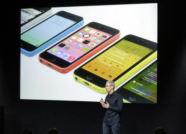 Tim Cook, CEO of Apple, speaks on stage during the introduction of the new iPhone 5c in Cupertino, Calif., Tuesday, Sept. 10, 2013. (AP Photo/Marcio Jose Sanchez)