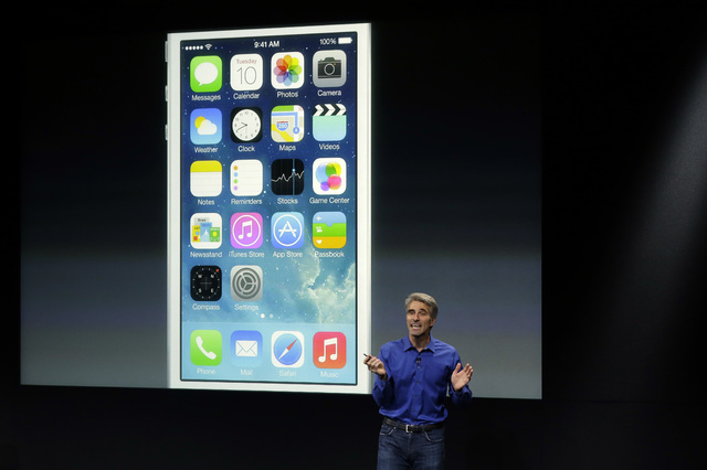 Craig Federighi, senior vice president of Software Engineering at Apple, speaks about the new iOS 7 release in Cupertino, Calif., Tuesday, Sept. 10, 2013. (AP Photo/Marcio Jose Sanchez)