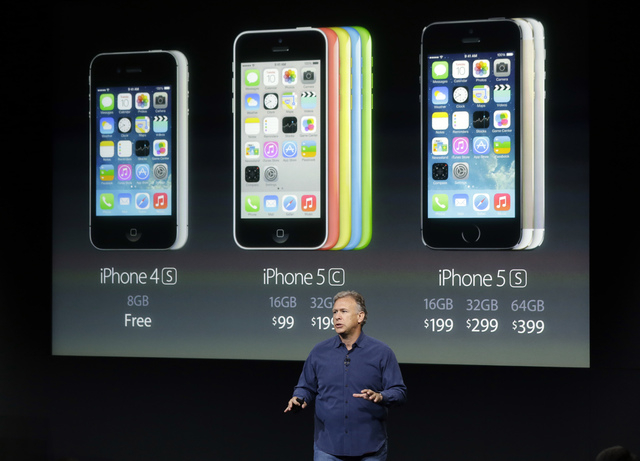 Phil Schiller, Apple's senior vice president of worldwide product marketing, speaks on stage during the introduction of the new iPhone 5c and 5s in Cupertino, Calif., Tuesday, Sept. 10, 2013. (AP  ...