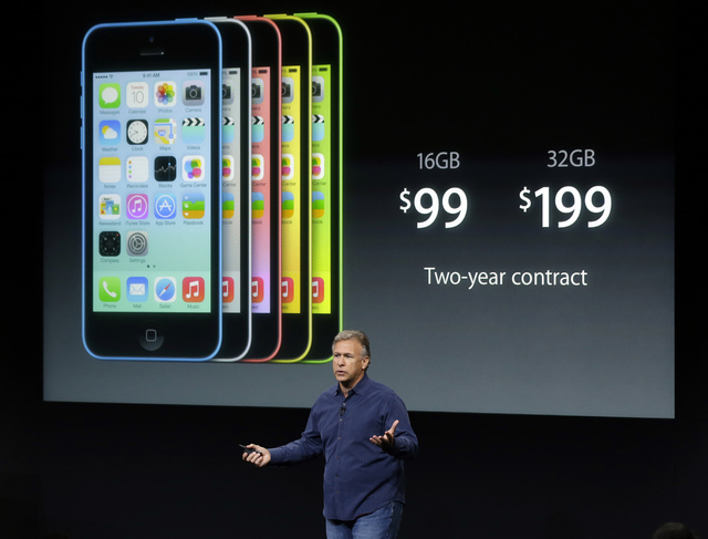Phil Schiller, Apple's senior vice president of worldwide product marketing, speaks on stage during the introduction of the new iPhone 5c in Cupertino, Calif., Tuesday, Sept. 10, 2013. (AP Photo/M ...