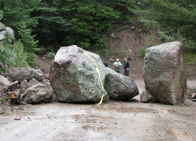 This photo released Wednesday Sept. 11, 2013 by Coconino County Sheriff's office shows investigators at the scene of a boulder slide where a Phoenix man was seriously injured while trying to move  ...