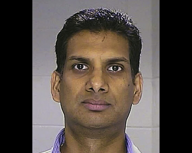 This Aug. 23, 2013 photo provided by the Illinois State Police shows Srinivasa Erramilli, of Aurora, Ill. Erramilli, a Chicago-area business traveler convicted of groping a fellow airline passenge ...