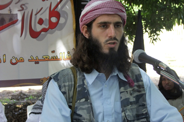 American-born Islamist militant Omar Hammami addresses a press conference of the militant group al-Shabab on May 11, 2011, at a farm in southern Mogadishu's Afgoye district in Somalia. Hammami, a  ...