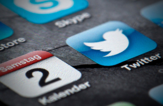 FILE - This Feb. 2, 2013, file photo shows a Twitter icon on the display of a smartphone in Berlin. The company tweeted Thursday, Sept. 12, 2013, that it has confidentially submitted an S-1 to the ...