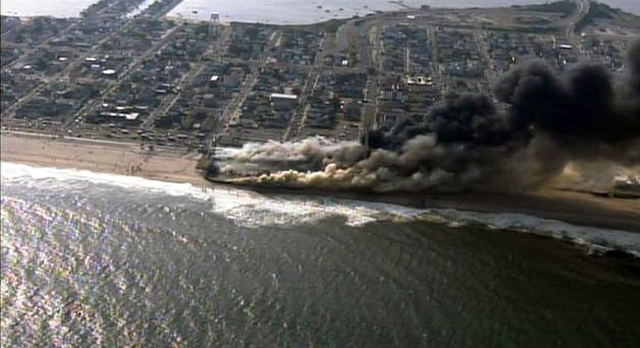 This frame grab from video provided by Fox 29 shows a raging fire in Seaside Park, N.J. on Thursday, Sept. 12, 2013.  The fire apparently started in an ice cream shop and spread several blocks dow ...