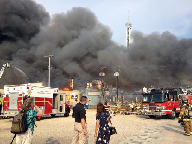 Firefighters battle a raging fire on the boardwalk in Seaside Heights, N.J. that apparently started in an ice cream shop and has spread several blocks down, Thursday, Sept. 12, 2013. The boardwalk ...