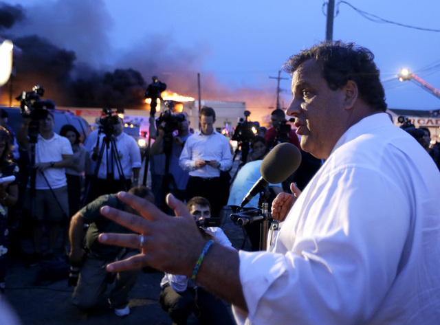 New Jersey Gov. Chris Christie addresses the media near the area hit by a massive fire on Thursday in Seaside Park, N.J.  (AP Photo/Julio Cortez)