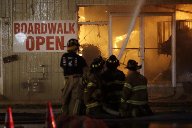 Firefighters battle a blaze in a building on the Seaside Park boardwalk on Thursday in Seaside Park, N.J. The fire began in a frozen custard stand on the Seaside Park section of the boardwalk and  ...