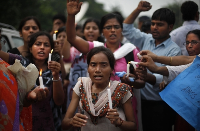 Indians hold candles and march outside a court to mark the verdict in the rape and murder of a student on a moving New Delhi bus last year, in New Delhi, India, Friday, Sept. 13, 2013. A judge on  ...