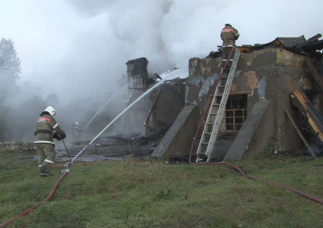 In this photo released by the Novgorod region branch of Russian Emergency Ministry, the ministry's Emergency Situations workers and fire fighters work at a site of a fire at a psychiatric hospital ...