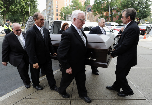 Pallbearers carry the casket of an enslaved man known as Mr. Fortune inside of St. John's Episcopal Church in Waterbury, Conn., Thursday, Sept. 12, 2013.  Mr. Fortune is being honored with a funer ...