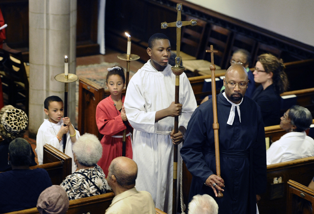 The Honorable Steven R Mullins, right, leads a procession at a memorial service for an enslaved man known as Mr. Fortune at St. John's Episcopal Church in Waterbury, Conn., Thursday, Sept. 12, 201 ...