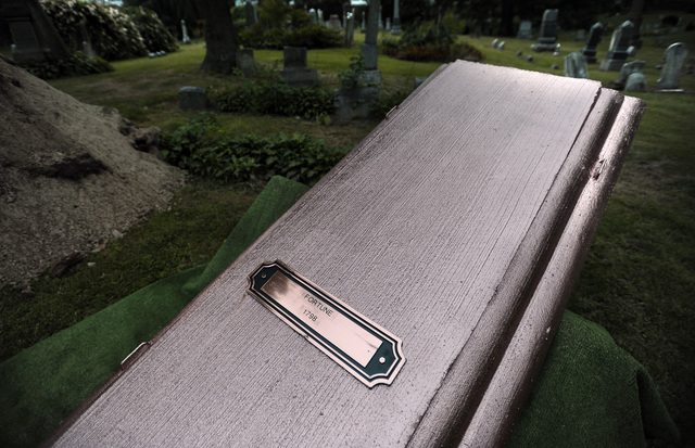 A casket cover bearing the name Fortune is affixed to a grave cover next to the plot for an enslaved man known as Mr. Fortune at Riverside Cemetery in Waterbury, Conn., Thursday, Sept. 12, 2013.   ...