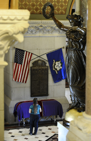 Lesia O. Ciupka Bongiovanni of Wethersfield pays respect at the casket of the remains of an enslaved man known as Mr. Fortune at the Capitol in Hartford, Conn., Thursday, Sept. 12, 2013.  Mr. Fort ...