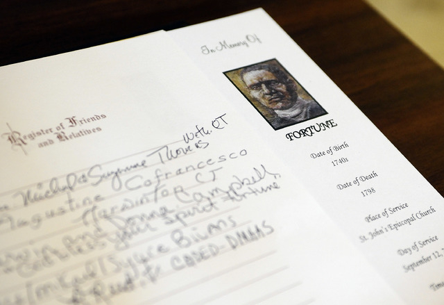 A memorial register book with entries from friends and family for an enslaved man known as Mr. Fortune is seen at the Capitol in Hartford, Conn., Thursday, Sept. 12, 2013. Mr. Fortune will be hono ...