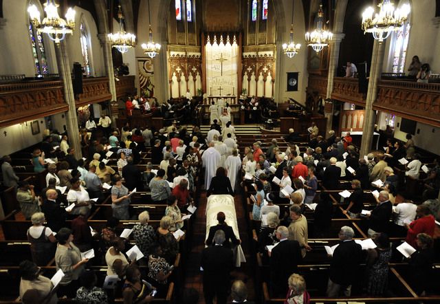 The casket of an enslaved man known as Mr. Fortune is moved past parishioners at St. John's Episcopal Church during a memorial service in Waterbury, Conn., Thursday, Sept. 12, 2013.  Mr. Fortune i ...