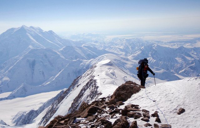 FILE - In this May 9, 2013 file photo released by the Alaska Air National Guard, Chief Master Sgt. Paul Barendregt climbs up the prow of the West Buttress on Mount McKinley conducting winter rescu ...