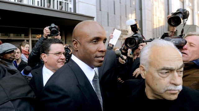 In this Friday, Dec. 16, 2011 file photo, former baseball player Barry Bonds leaves federal court after being sentenced for obstructing justice in a government steroids investigation in San Franci ...