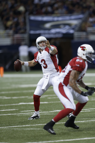 Arizona Cardinals Carson Palmer #3 drops back and passes the football during the NFL game against the St. Louis Rams at the Edward Jones Dome in St. Louis MO., Sunday, Sept. 8, 2013. (AP Photo/Mik ...