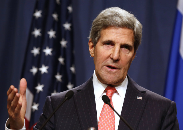U.S. Secretary of State John Kerry answers questions during a joint media conference with Russian Foreign Minister Sergei Lavrov, not pictured, following meetings regarding Syria, at a news confer ...