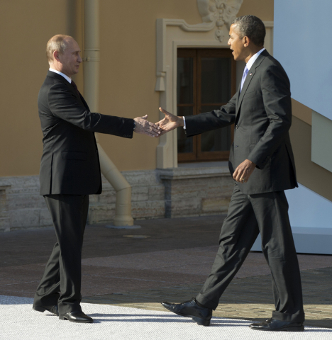 In this Sept. 5, President Barack Obama reaches to shakes hands with Russia's President Vladimir Putin during arrivals for the G-20 summit in St. Petersburg, Russia. (AP Photo/Pablo Martinez Monsi ...