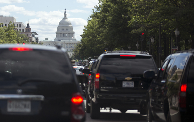 President Barack Obama's motorcade moves up Pennsylvania Ave. in the direction of the U.S. Capitol, center, Saturday, in Washington, en route to Andrews Air Force Base to golf. (AP Photo/Carolyn K ...