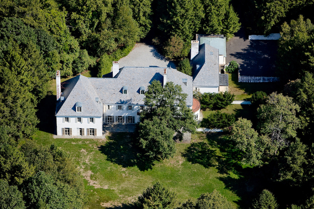 In this Aug. 2010 photo provided by Barbara Cleary's Realty Guild, Huguette Clark's New Caanan, Conn., estate is shown. Surrounded by 52 acres of land, no one has lived at the estate in over two d ...