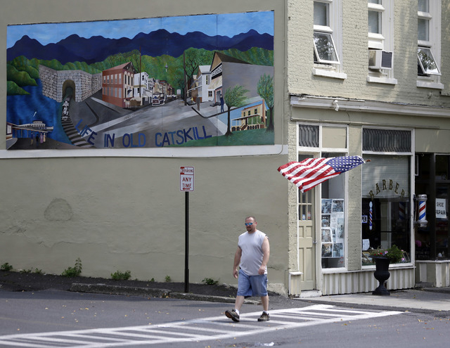 A pedestrian walks along Main Street on Thursday, Sept. 12, 2013, in Catskill, N.Y. A group of locals in this Hudson River village are offering the right chef space on Main Street free rent for a  ...
