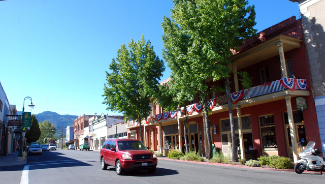 In this Sept. 6, 2013 photo, a car drives down Miner Street past the historic Franco American Hotel in Yreka, Calif. The former gold mining town served as the temporary capital of a proposed State ...