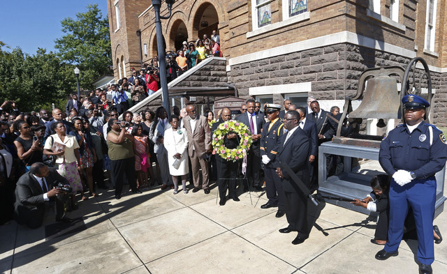 Churchgoers file outside the church as a wreath is carried at the 16th Street Baptist Church in Birmingham, Ala., Sunday, Sept. 15, 2013. The congregation gathered outside the church for the wreat ...