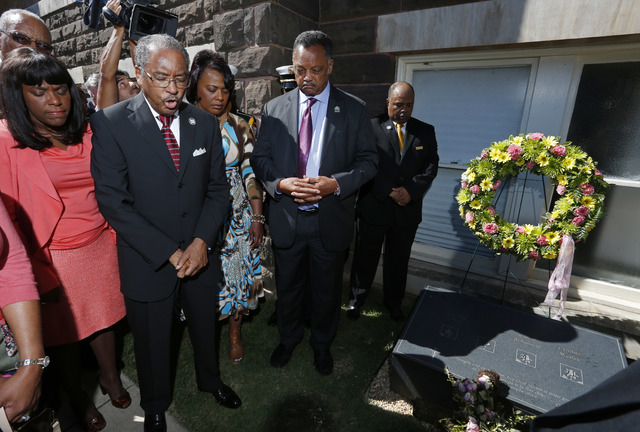Rev. Julius Scruggs, second from left, leads people in prayer during a wreath laying ceremony at the 16th Street Baptist Church in Birmingham, Ala., Sunday, Sept. 15, 2013. The congregation gather ...