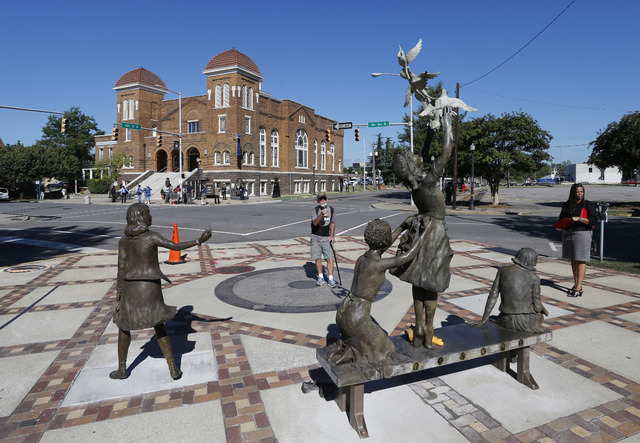 A newly unveiled statue honoring four slain young church girls graces the corner of Kelly Ingram Park, across the street from the 16th Street Baptist Church in Birmingham, Ala., Sunday, Sept. 15,  ...