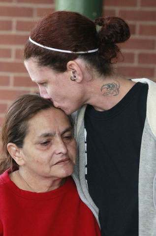 Linda Ramirez, left, is comforted by family friend, Dawn Bennington, right, while exiting Tiffin Mercy Hospital on Sunday, Sept. 15, 2103 in Tiffin, Ohio. Ramirez is the grandmother to the the fiv ...