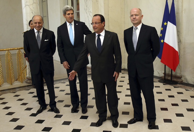 From left, French Foreign Minister Laurent Fabius, U.S. Secretary of State John Kerry, French President Francois Hollande and  British Foreign Secretary William Hague, pose in the lobby of the Ely ...