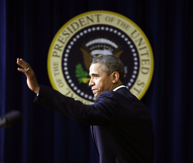 President Barack Obama waves as he walks off stage after speaking in the South Court Auditorium on the White House complex, Monday, Sept. 16, 2013, in Washington. After weeks of intense focus on t ...