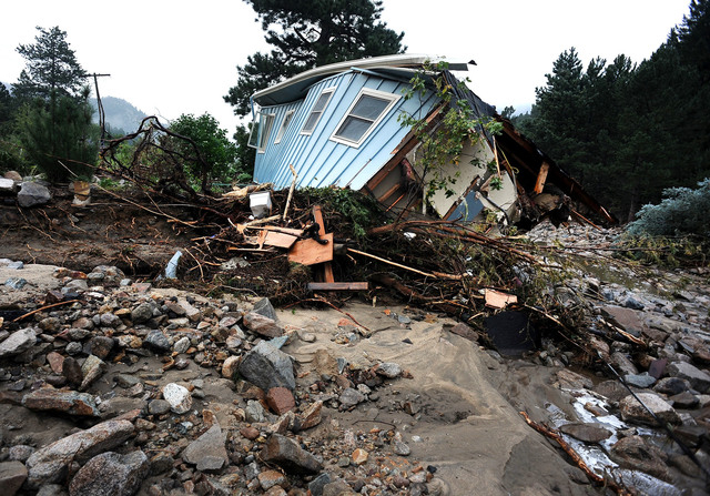 A house lays completely demolished in what was the path of the recent floods that have destroyed the town of Jamestown, Colo., on Sunday Sept. 14, 2013.  No one has been able to access the town un ...