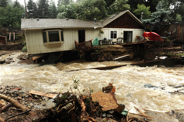 What looks like a river in fact used to be the front and back yards of the residents of these homes  in Jamestown, Colo.,  on Sunday Sept. 15, 2013.  People in the town say the the Little Jim Cree ...