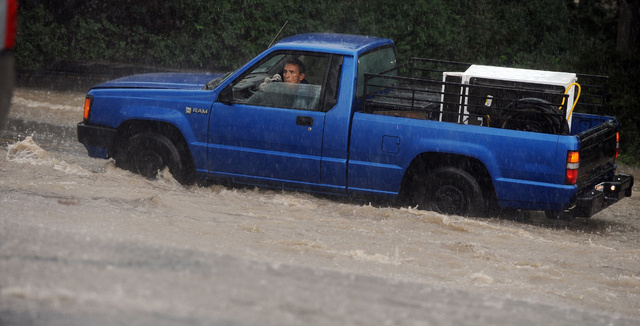 A man looked out the window of his truck after it stalled in rising water in Colorado Springs, Colorado, on Sunday, Sept. 15, 2013.  Many streets were flooded with rainwater during several heavy s ...