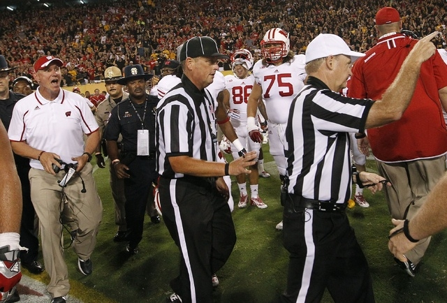 Wisconsin head coach Gary Andersen, far left, yells at officials as they attempt to leave the field after an NCAA college football game against Arizona State on Saturday, Sept. 14, 2013, in Phoeni ...