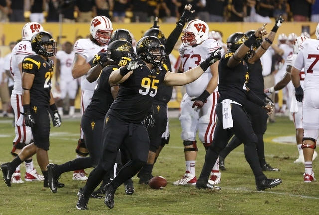 Arizona State's Gannon Conway (95) celebrates a win against Wisconsin as time expires in the second half of an NCAA college football game on Saturday, Sept. 14, 2013, in Phoenix.  Arizona State de ...