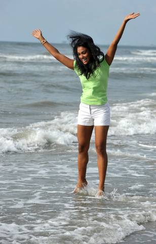 Miss America 2014 Nina Davuluri poses for photographers during the traditional dipping of the toes in the Atlantic Ocean the morning after being crowned Miss America, Monday, Sept. 16, 2013, in At ...