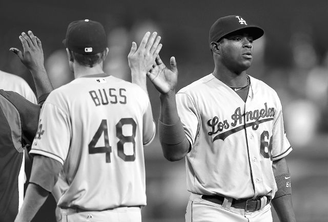 Los Angeles Dodgers' Yasiel Puig, right greets Nick Buss after their win over the Arizona Diamondbacks after a baseball game, Tuesday, Sept. 17, 2013, in Phoenix. The Dodgers won 9-3. (AP Photo/Ma ...