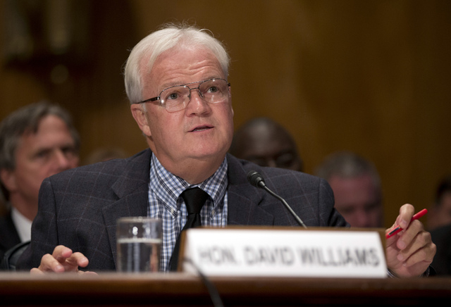 David Williams, the inspector general of the United States Postal Service speaks at the Senate Homeland Security and Governmental Affairs Committee hearing on Capitol Hill, Thursday, Sept. 19, 201 ...