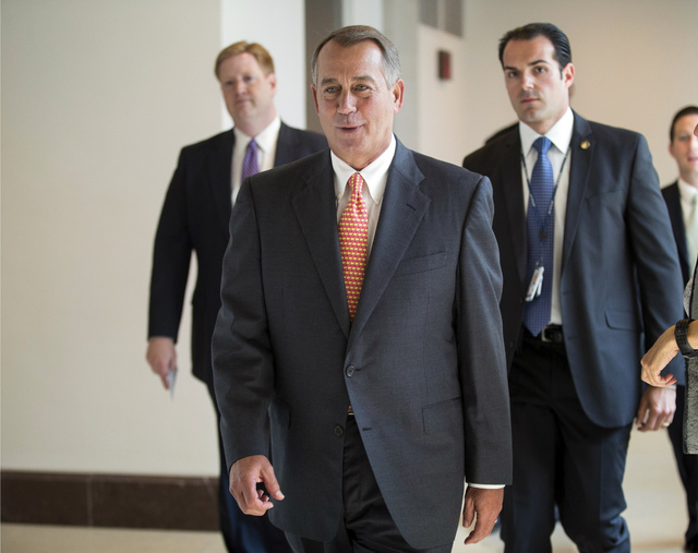 Speaker of the House John Boehner, R-Ohio, returns to his office after speaking with reporters about the deadline to fund the government and the fight among House Republicans, on Capitol Hill in W ...