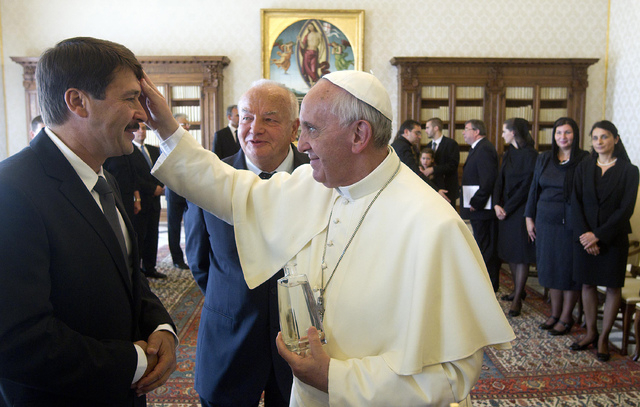 Pope Francis meets Hungary's President Janos Ader, during a private audience at the Vatican, Friday, Sept. 20, 2013. (AP Photo/Claudio Peri, Pool)